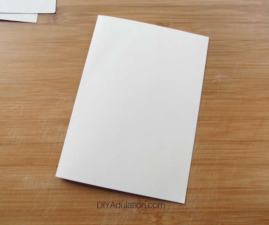 Blank Card on Wood Background