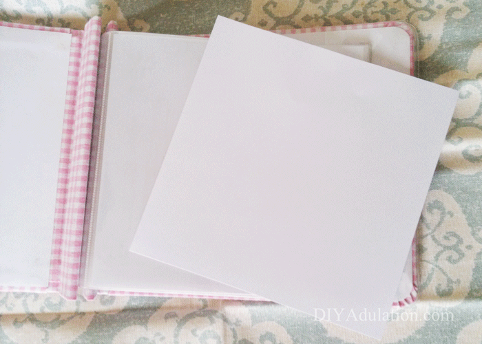 Blank White Paper Laying on Open Scrapbook