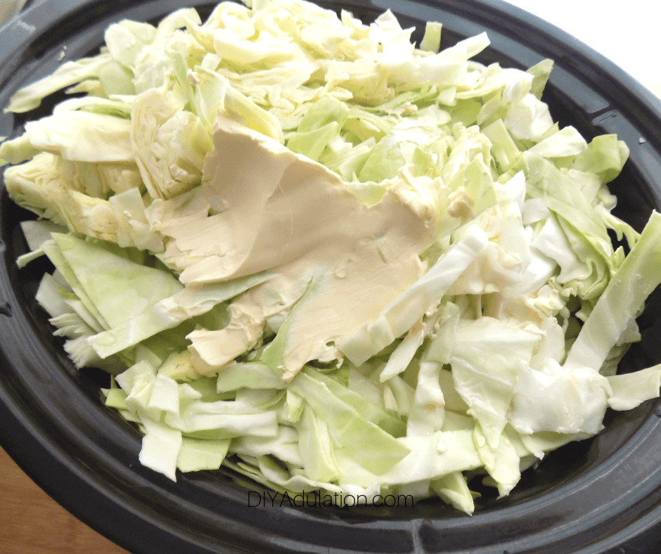 Butter on Sliced Cabbage in Crock Pot
