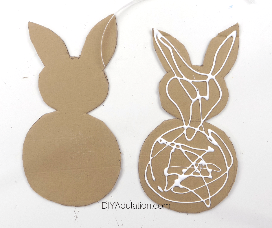 Cardboard Bunny with Glue on It Next to Plain Cardboard Bunny