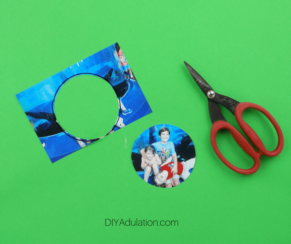 Circle Cut Out of Picture next to Scissors