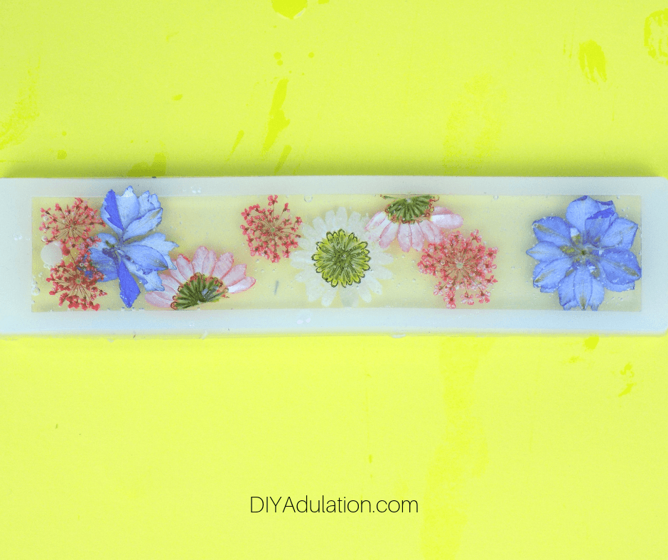 Clear Resin over Pressed Flowers in Bookmark Mold