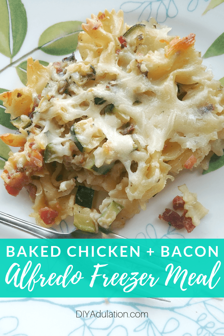 Close Up of Alfredo Pasta on Plate with text overlay - Baked Chicken and Bacon Alfredo Freezer Meal