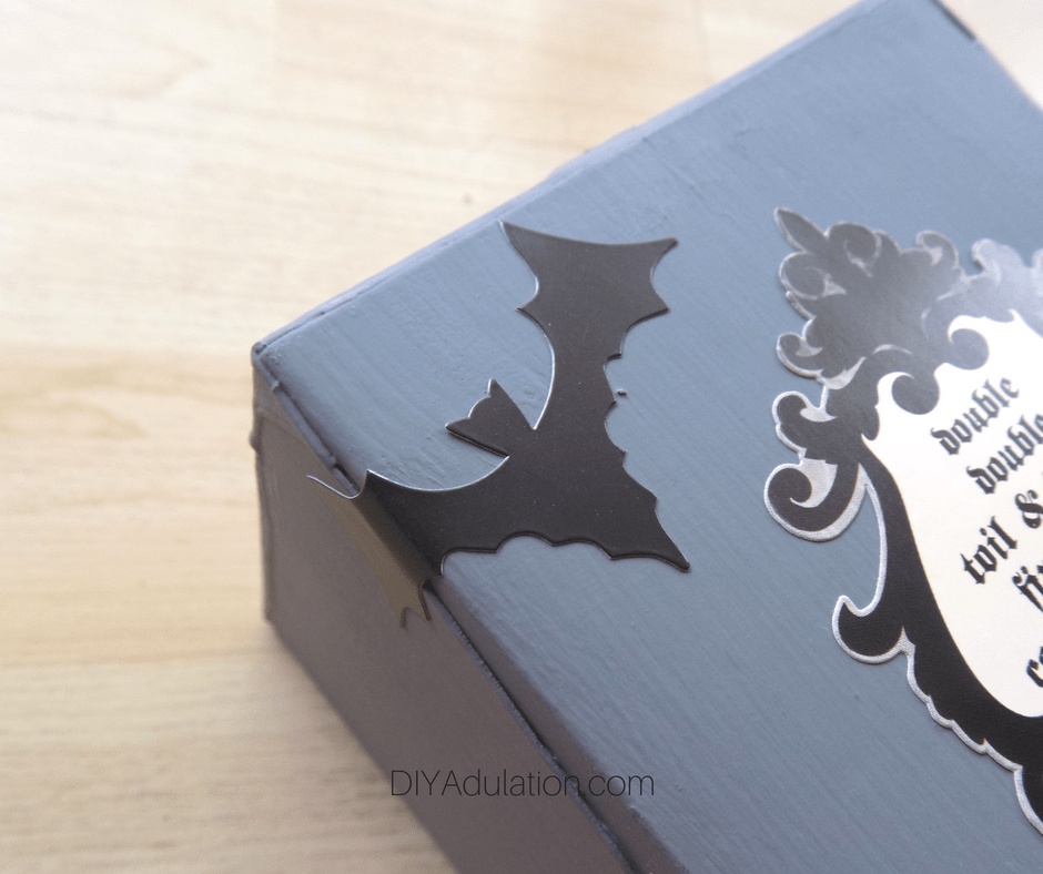 Close Up of Bat Sticker Wrapped Around Edge of Box