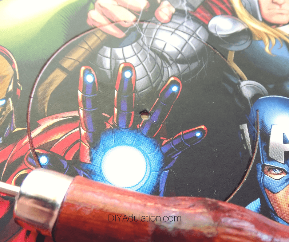 Close Up of Circle Drawn on Avengers Card with Hole in the Middle