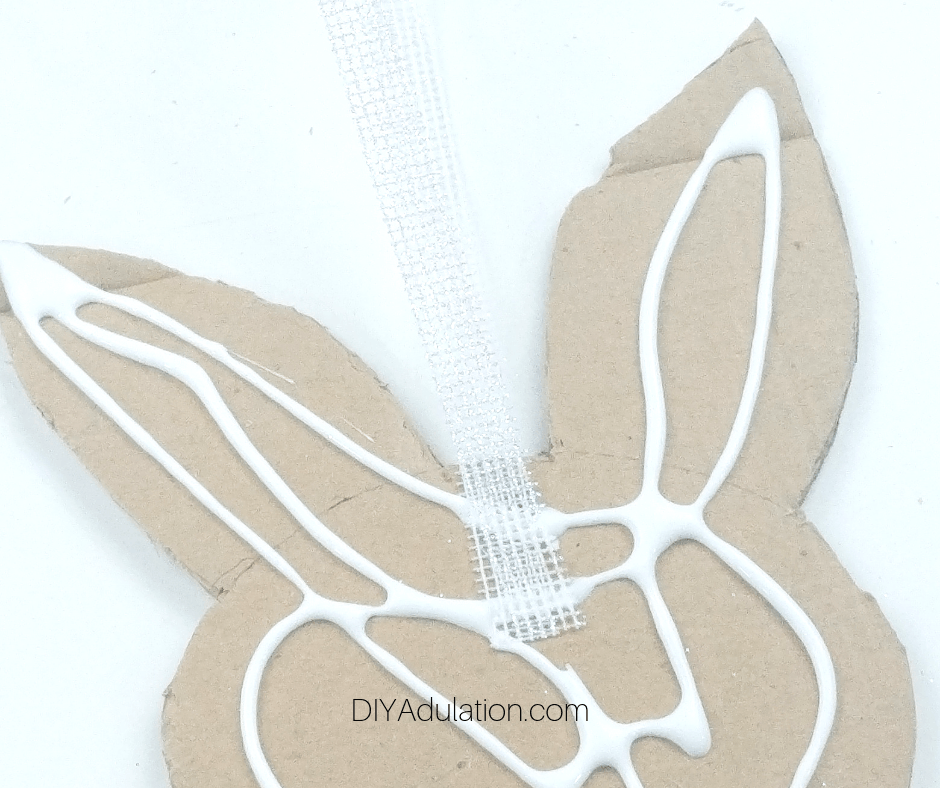 Close Up of Folded Ribbon Glued to Cardboard Bunny