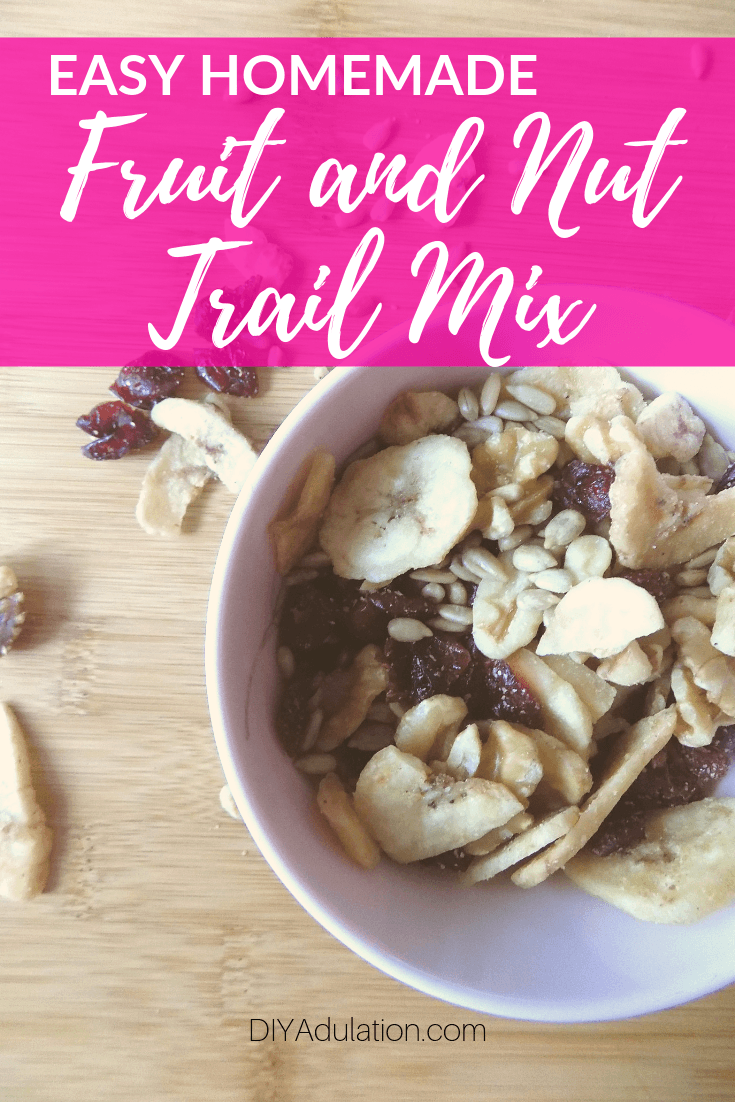 Close up of Bowl of Trailmix with text overlay - Easy Homemade Fruit and Nut Trail Mix