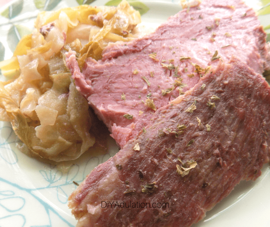 Close up of Corned Beef next to Cabbage on Plate