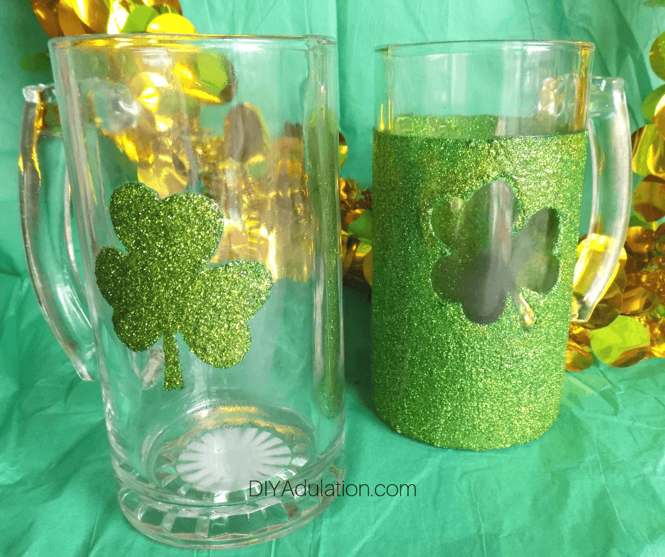 Close up of Glittery Shamrock Mugs on Green Background