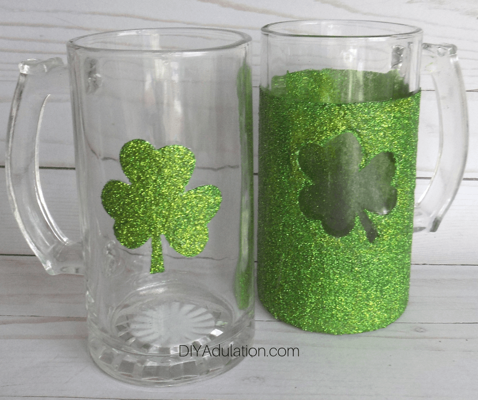 Close up of Glittery Shamrock Mugs on Wood Background