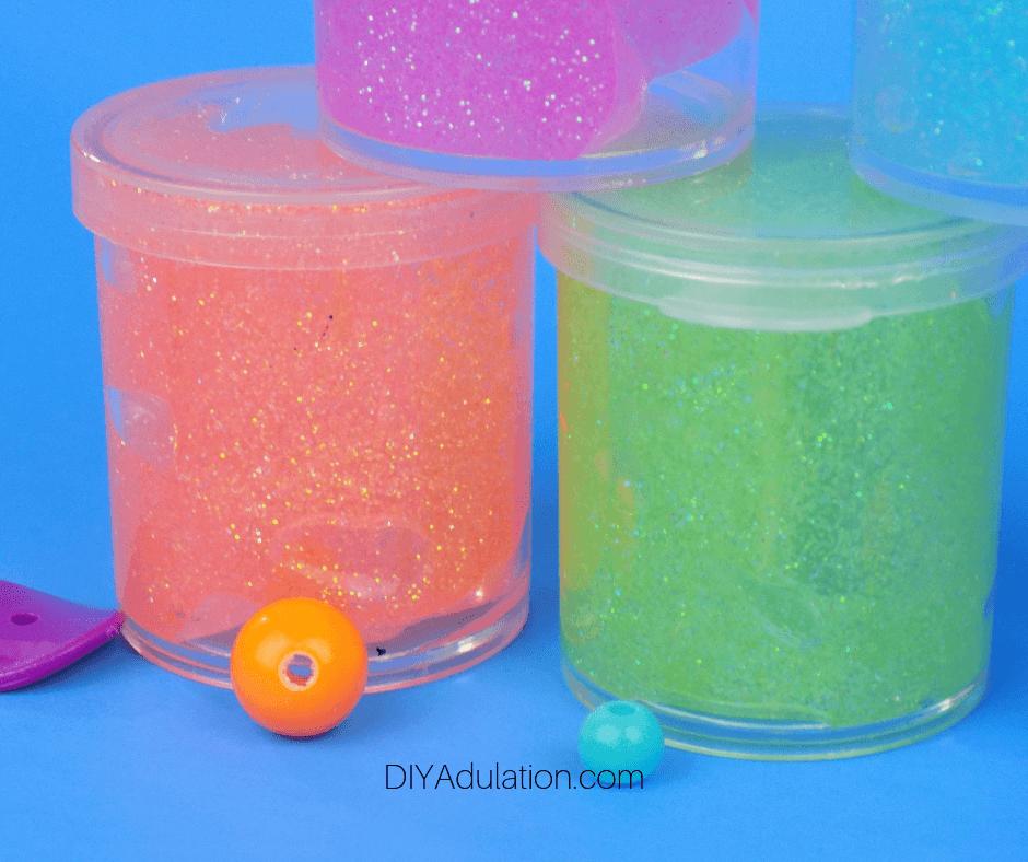 Close up of Orange and Green Body Glitter Gel