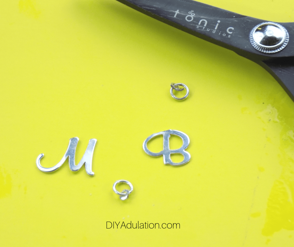 Close up of Silver Monogram Charms