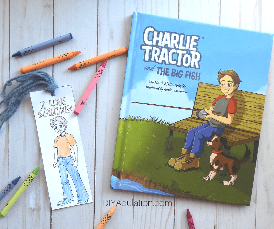 Colored Charlie Tractor Bookmark Next to Charlie Tractor and the Big Fish Book