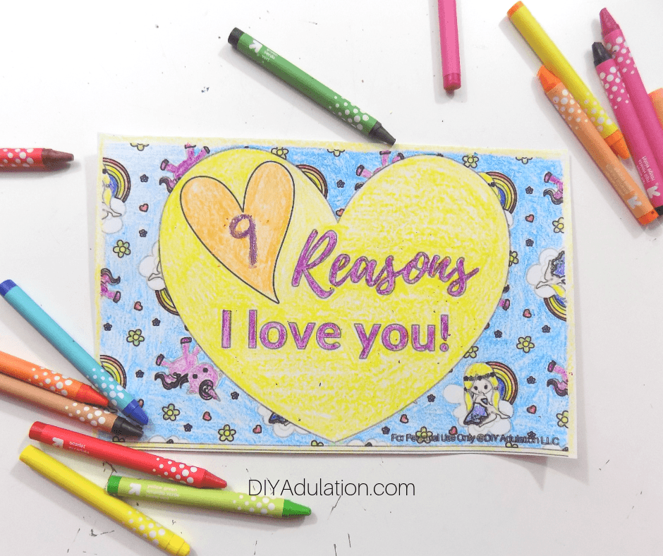 Colored Covered of Valentine Book Next to Crayons