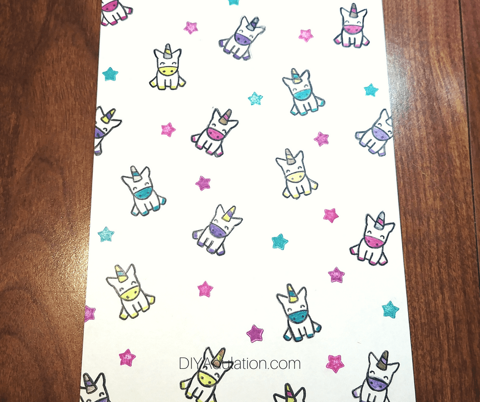 Colorful Unicorns and Stars on White Paper