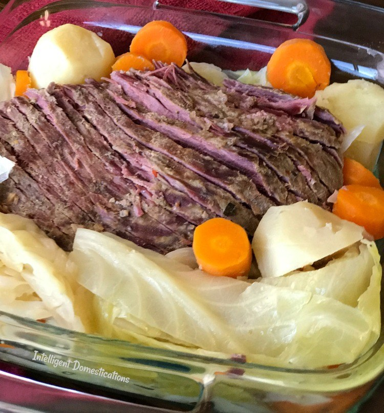 Glass dish full of corned beef and cabbage