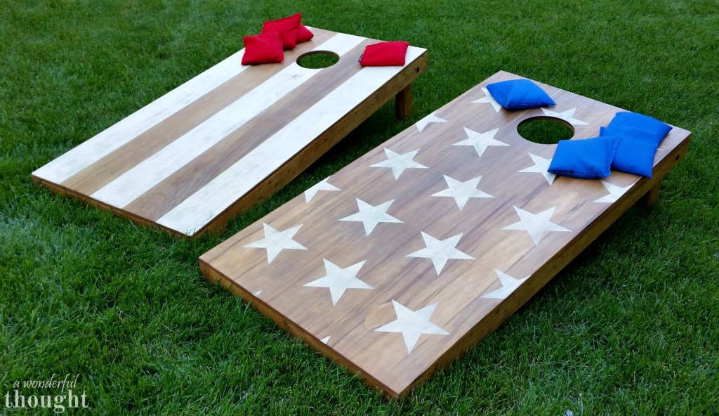 Wooden Stars and Stripes Cornhole Boards on Lawn