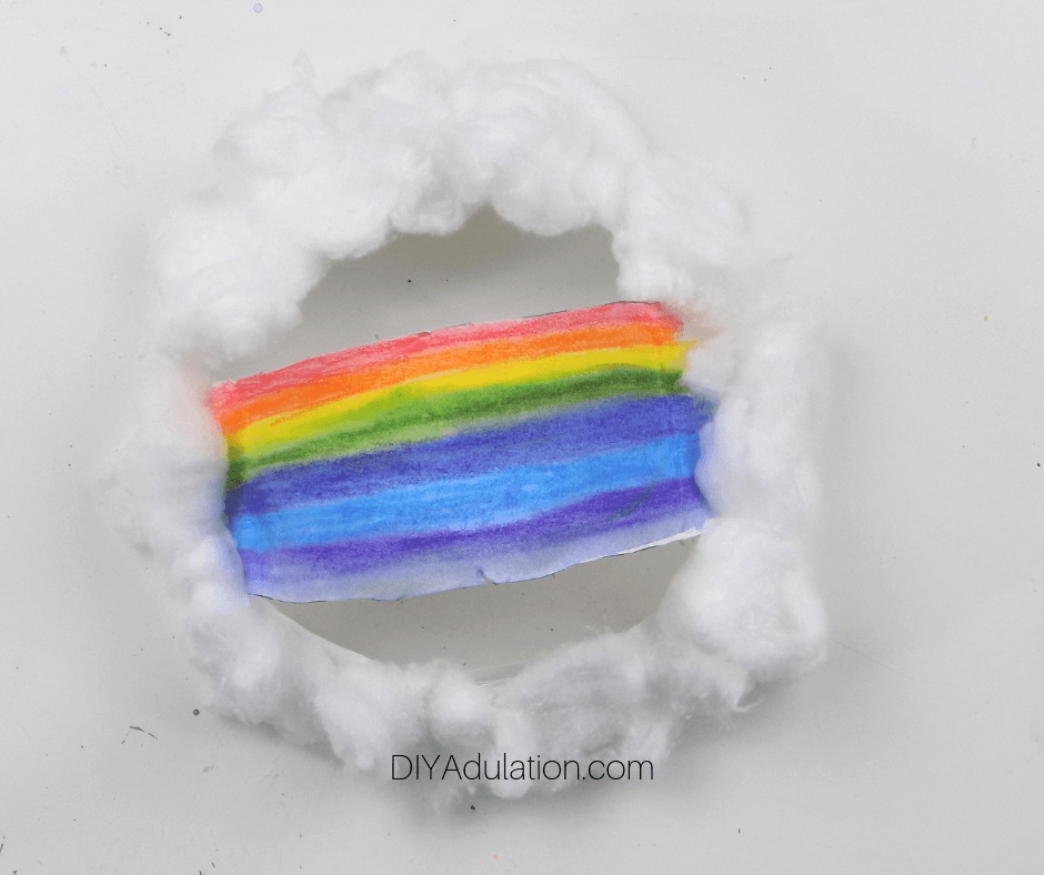 Cotton Glued to Around Rainbow Paper Plate Edge