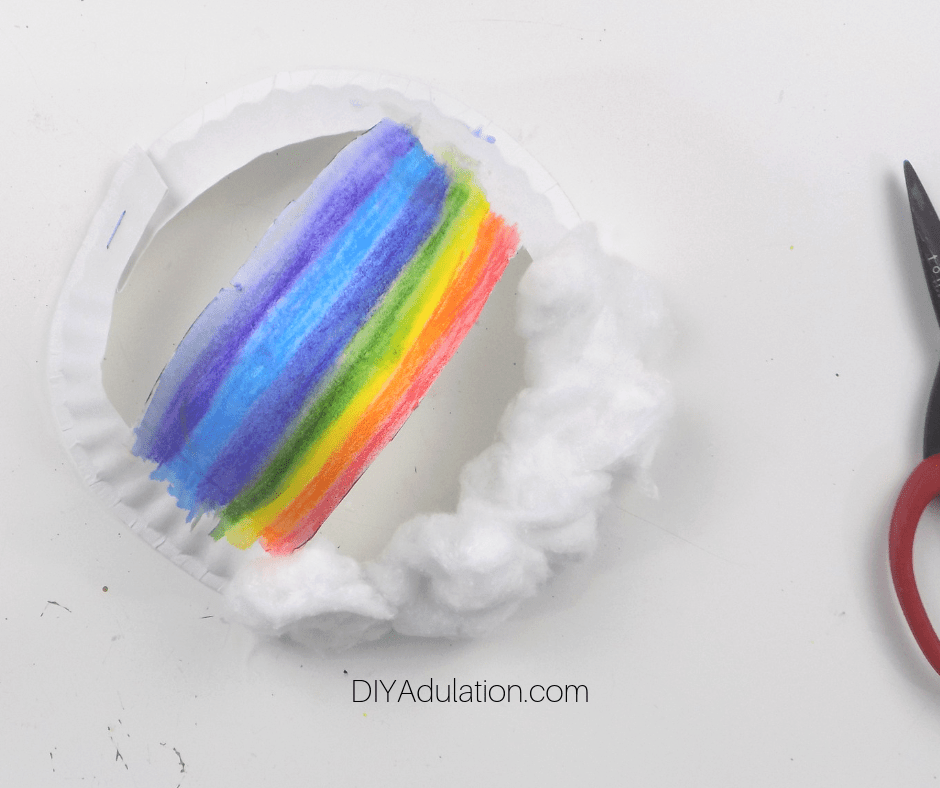 Cotton Glued to Half Rainbow Paper Plate Edge