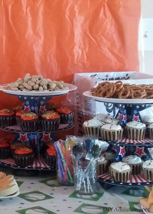 Treat stands loaded with cupcakes and sweets on party table