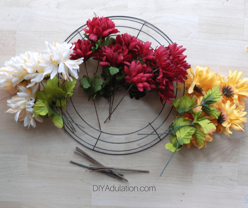 Cut Fake Flower Stems on Top of Wire Wreath Form