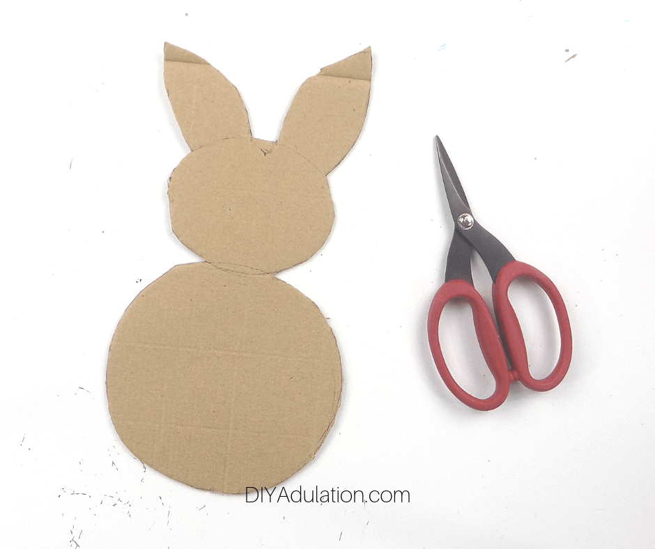 Cut Out Cardboard Bunny next to Scissors