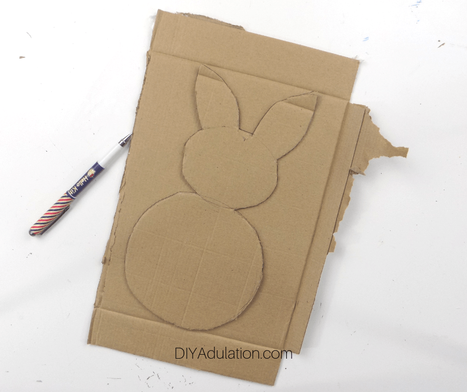 Cut Out Cardboard Bunny on top of Piece of Cardboard