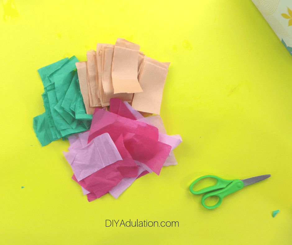 Cut Up Pieces of Tissue Paper next to Scissors