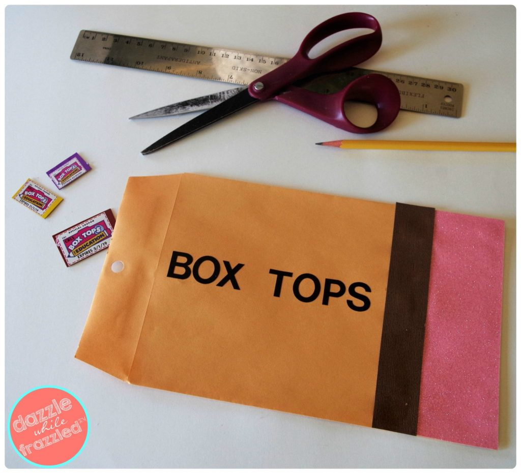 Box tops envelope with school supplies