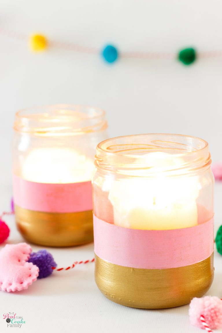 Pink and gold glass candle holders with candles