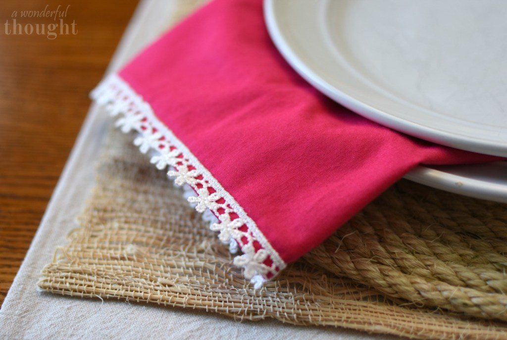Close Up of Fabric Napkin Hanging Between Plates
