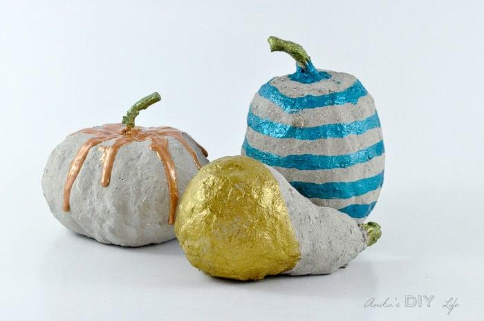 painted concrete pumpkins