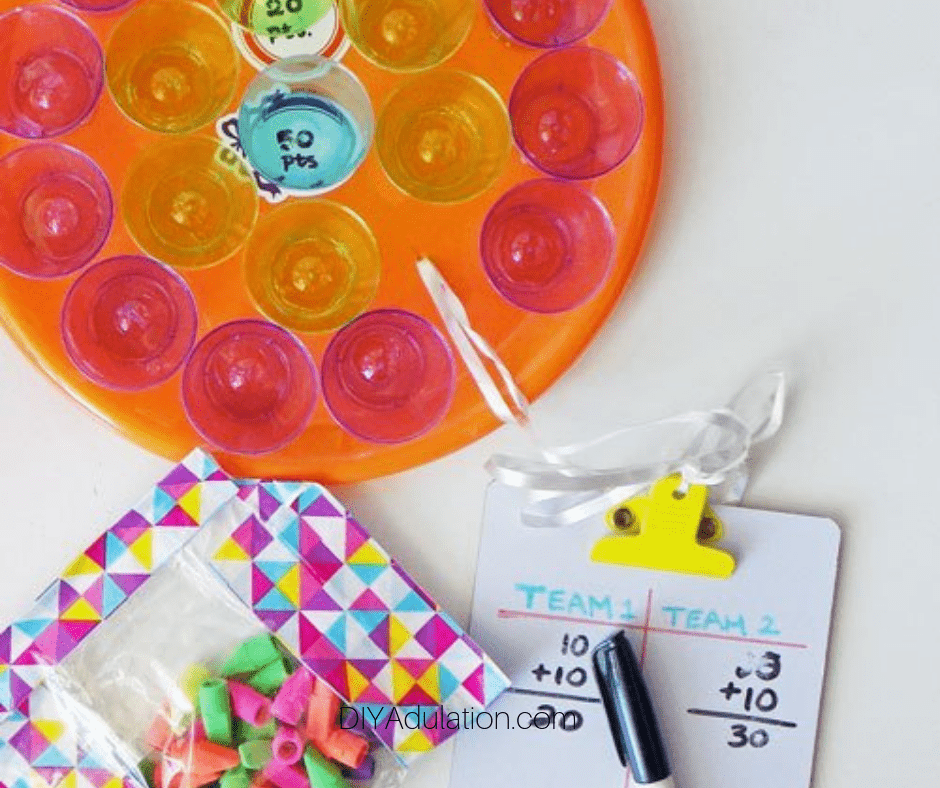 Dollar Store Eraser Toss Game next to Erasers and Scoreboard