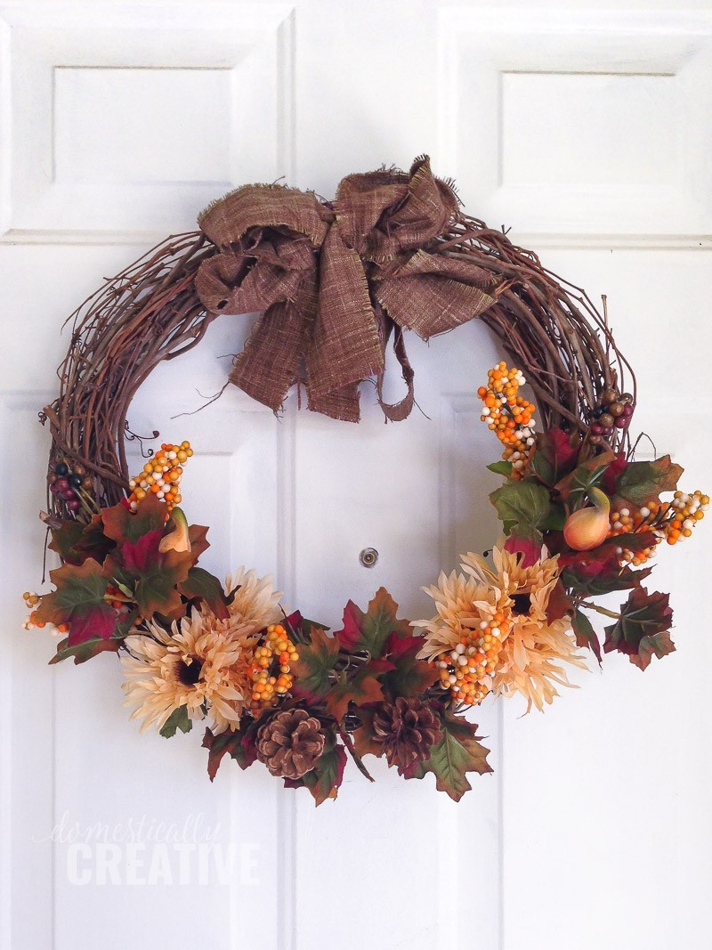 Grapevine wreath with fall flowers and leaves