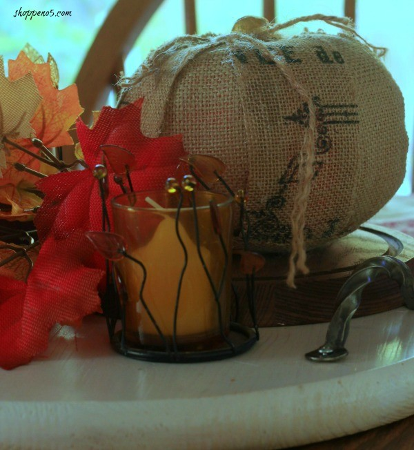 fall vignette with candle and burlap pumpkin