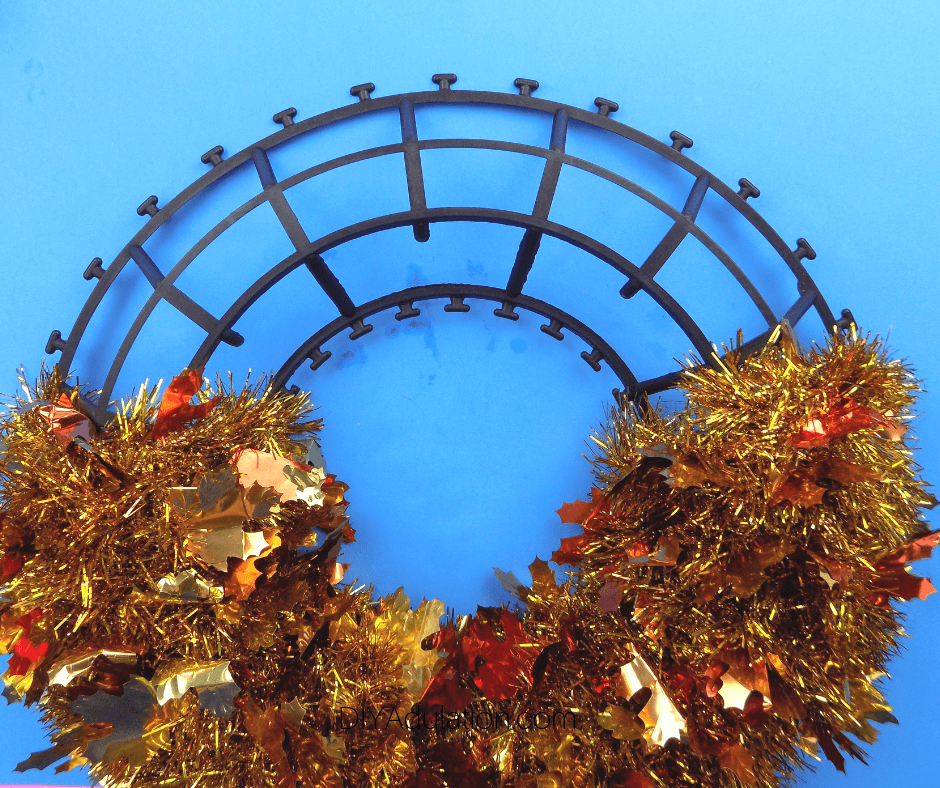Fall Garland Wreath with Half of the Garland Removed from Plastic Base