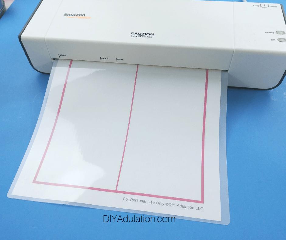 Feeding Pink Chore Chart into Laminator