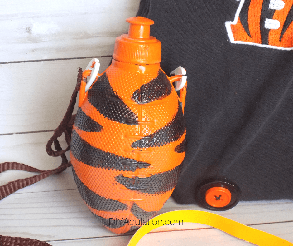 Football Noisemakers next to a Bengals Purse