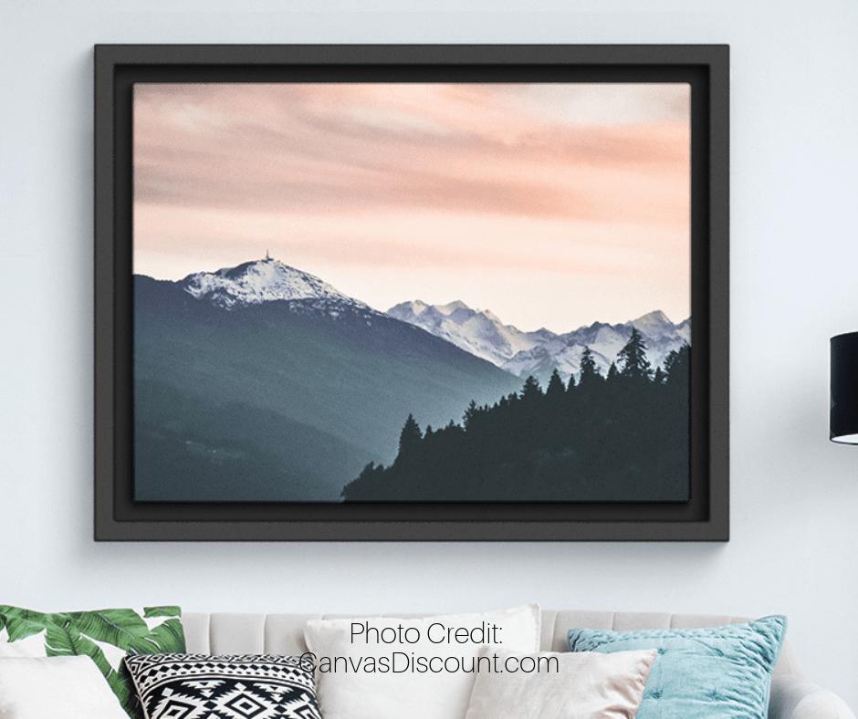 Framed Mountainscape Photo on Wall Above Couch