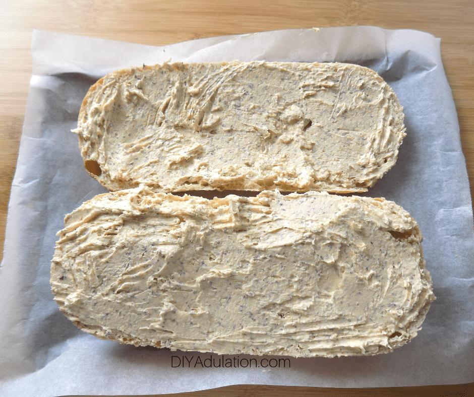 Garlic Butter on Halves of Bread Loaf