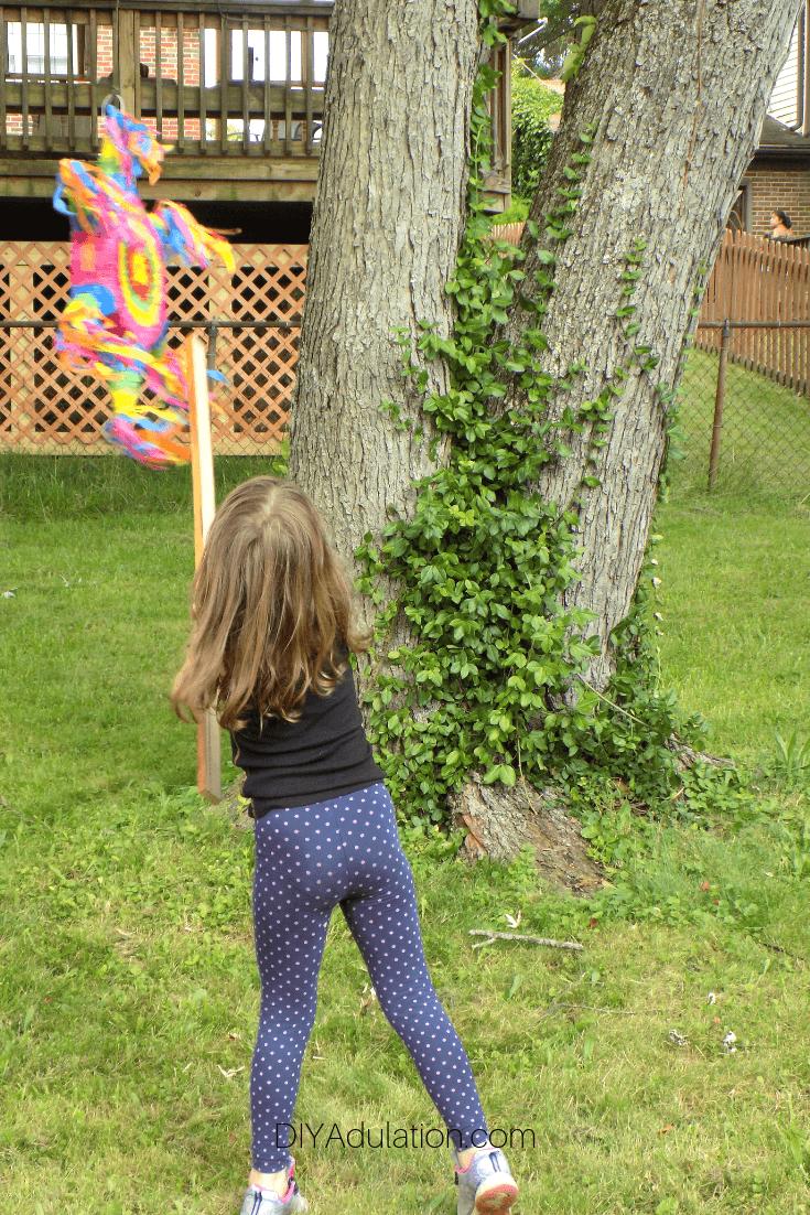 Girl Swinging at Pinata