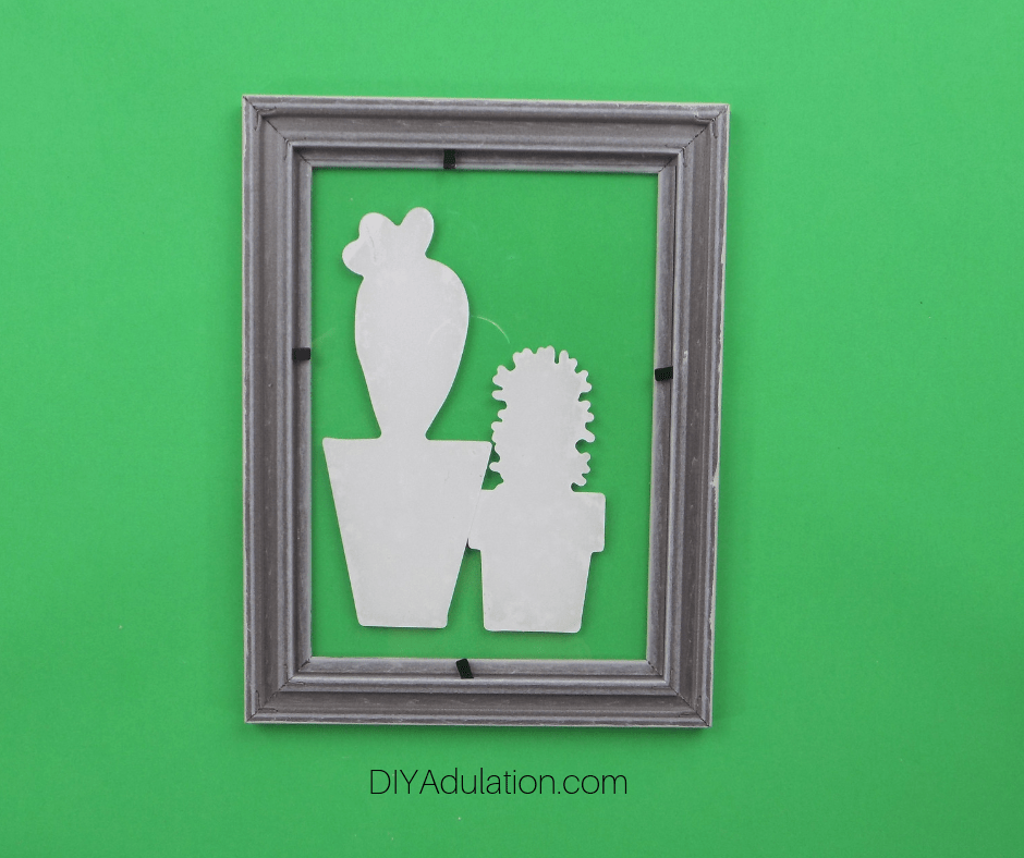 Glass with Stickers Secured in Picture Frame