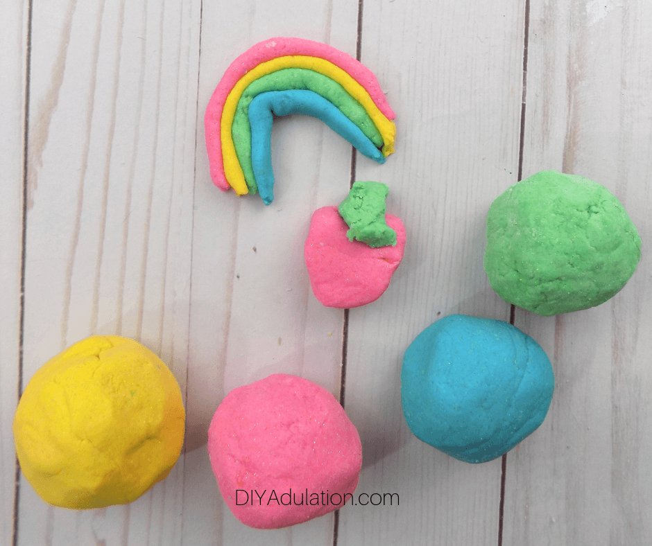 Glittery Play Dough Creations next to Balls of Play Dough