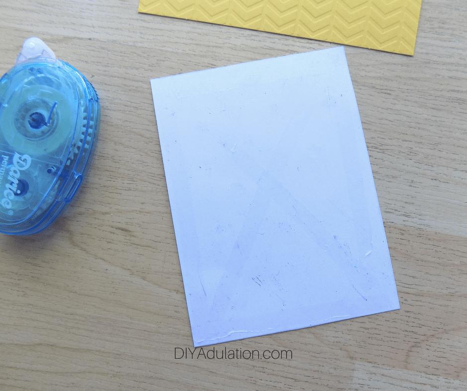 Glue x on White Paper