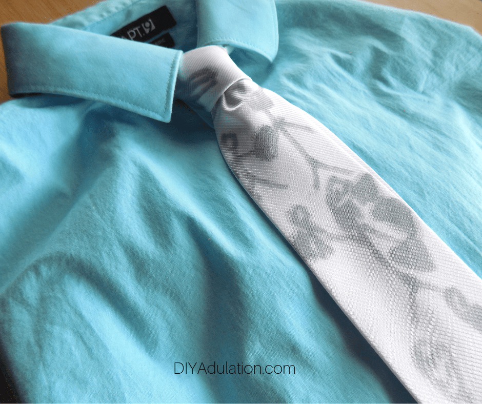 Gray and White Drawing Tie on Teal Button Up Shirt