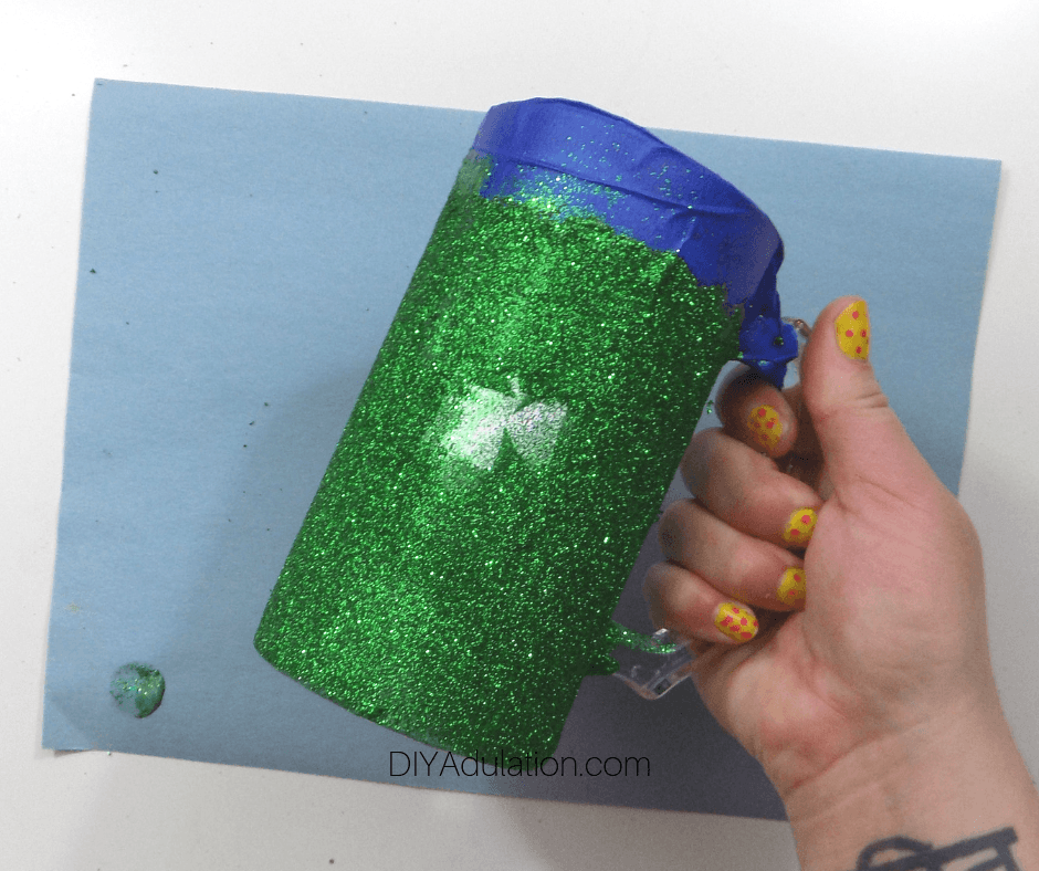 Hand Holding Green Glitter Covered Stein