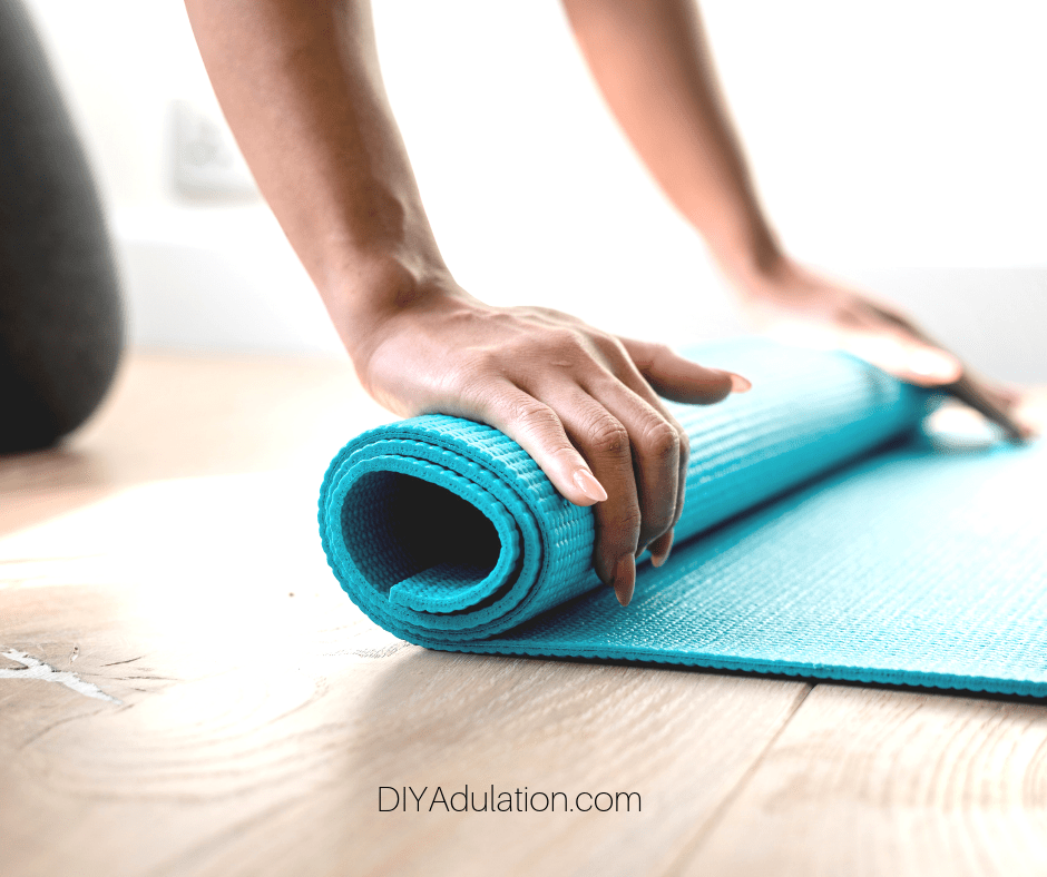 Hands Rolling Up Yoga Mat