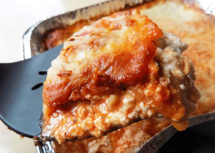 Spatula full of lasagna