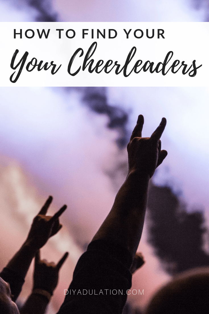 Hands in the air making rock symbol with text overlay: How to Find Your Cheerleaders