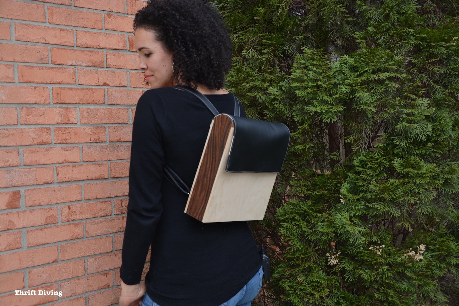 Woman with small wooden backpack on